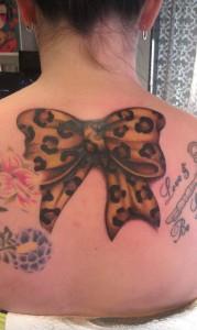 leopard print bow tattoo