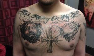 religious chest tattoo