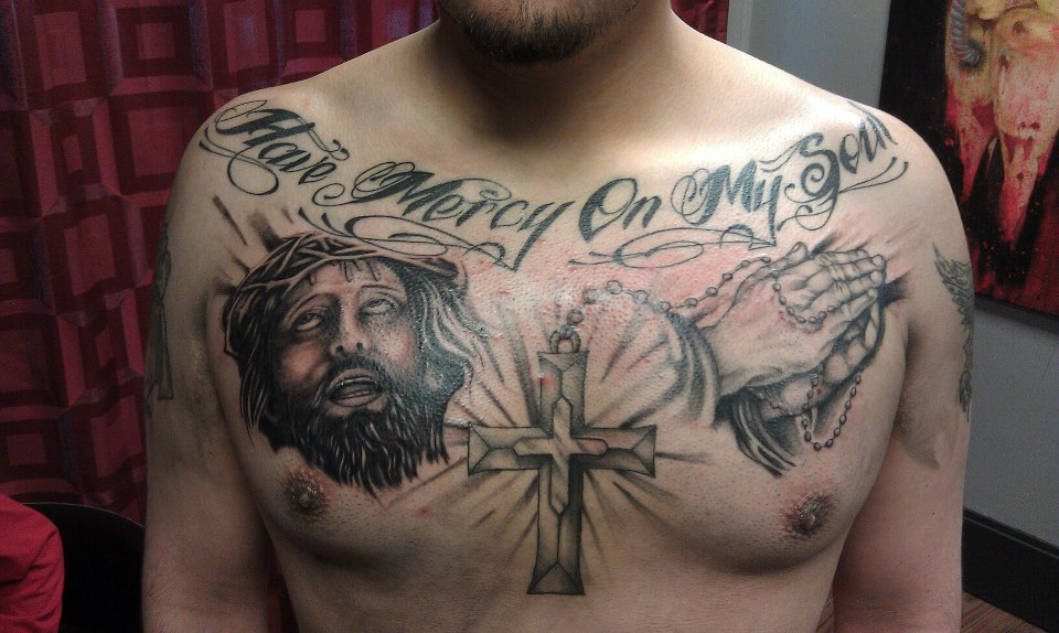 Lettering tattoos headless hands custom tattoos shop for Religious chest tattoos